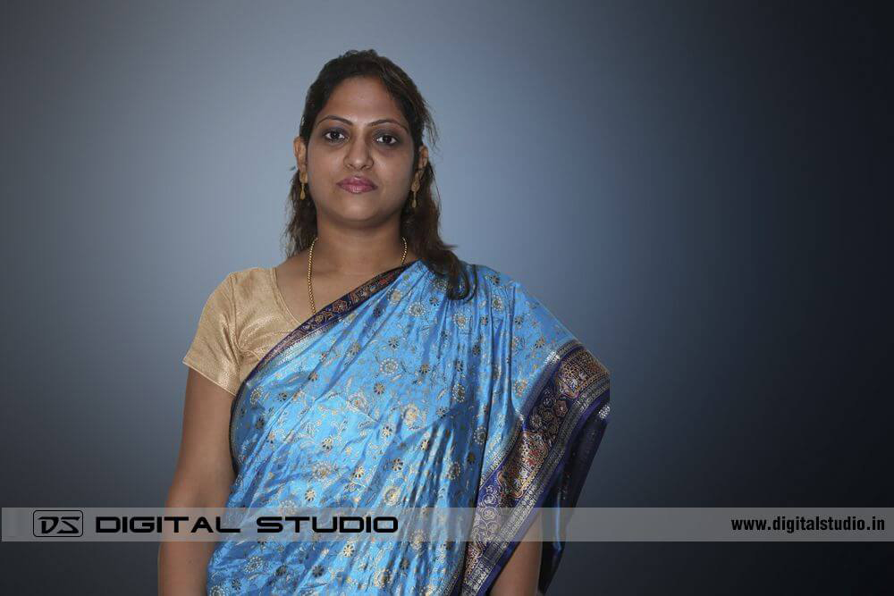 Lady wearing blue sari in Corporate Headshot