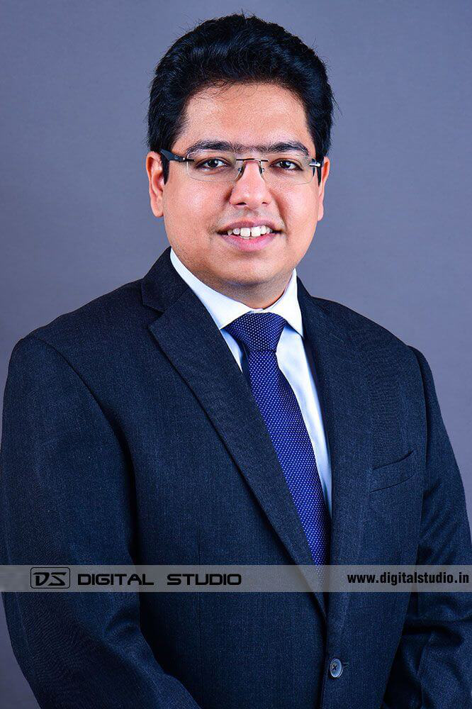Male corporate headshot withblue backdrop
