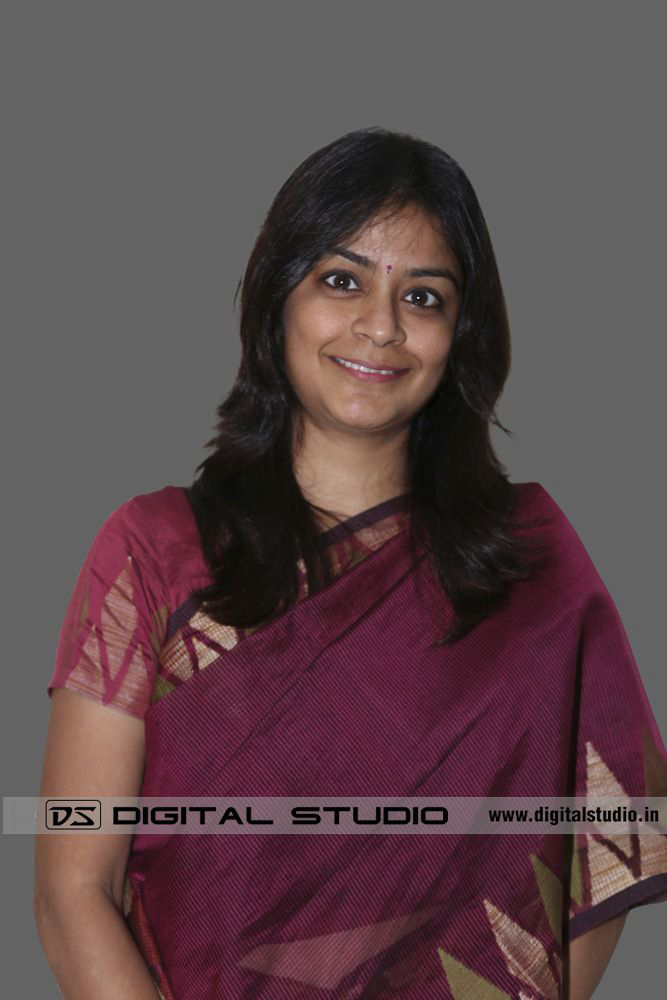 Smiling lady executive in maroon sari