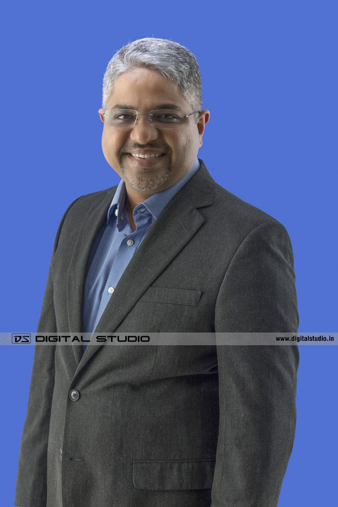 managing director on blue backdrop