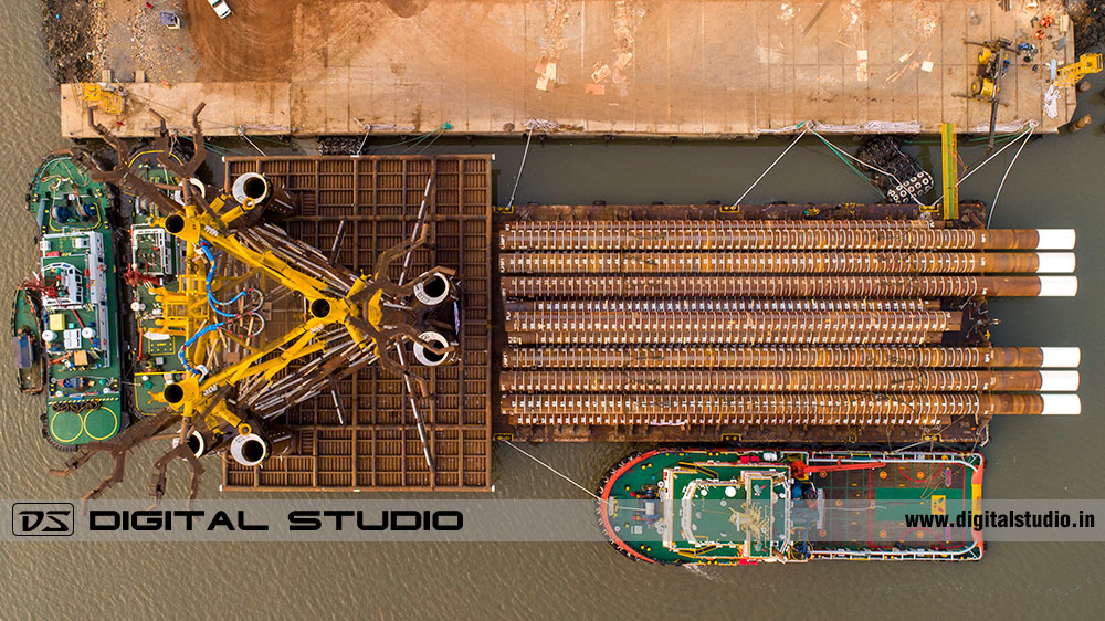 Top down photo of a barge with large machine