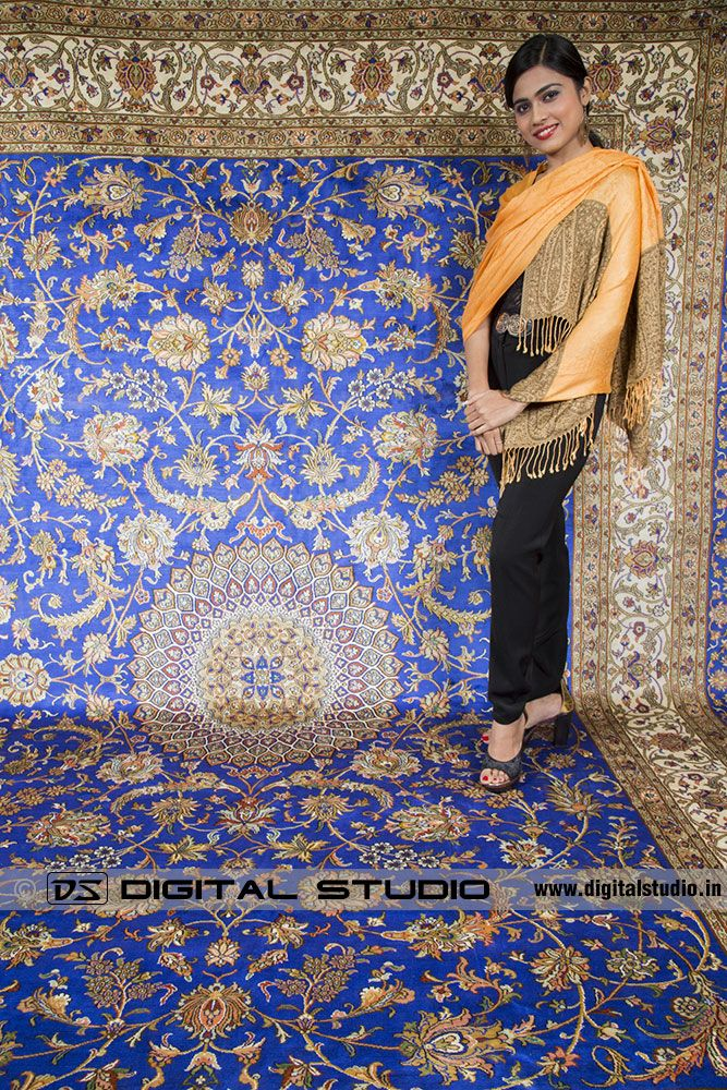 Model standing on Kashmir Silk carpet