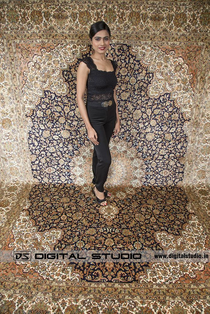 Model wearing black dress on Kashmir silk Carpet