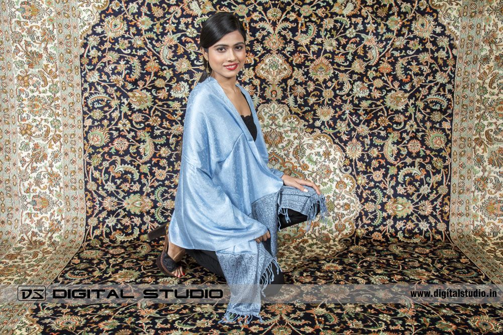 Model with Pashmina on a handmade oriental carpet