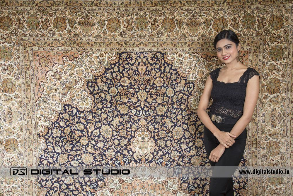 Silk carpet with model wering black dress