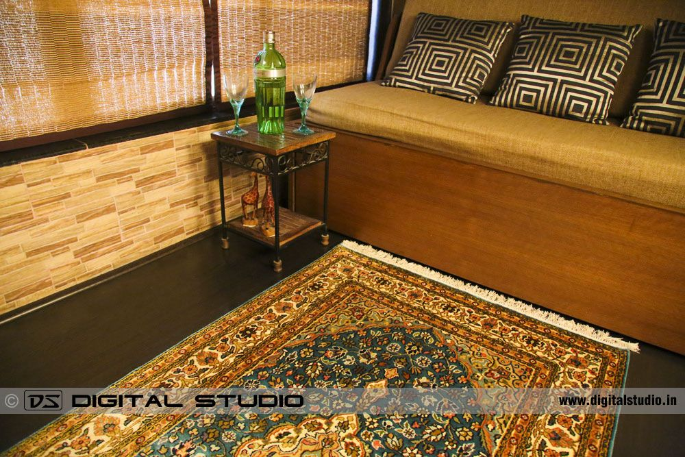 Oriental hand made carpet with wine and glasses setup