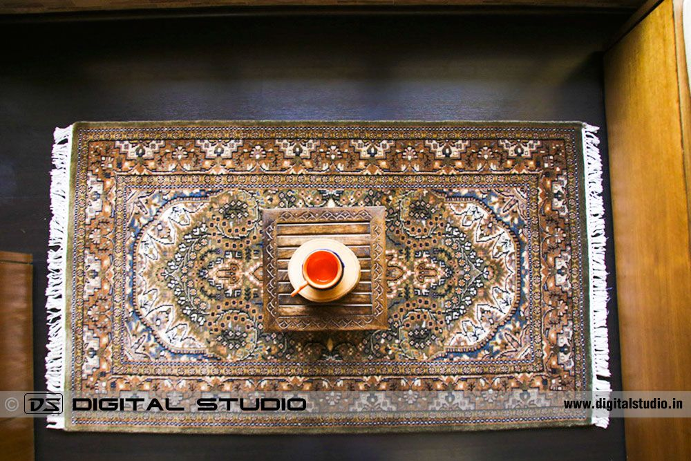 Top view of oriental hand made carpet on wood floor