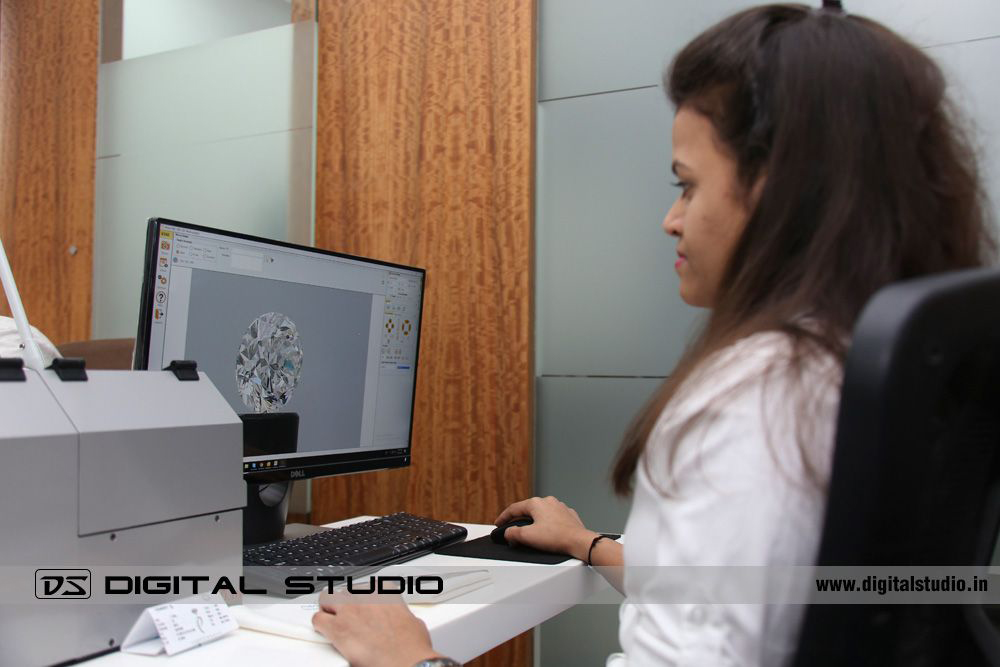 Female working on machine to take video of diamonds
