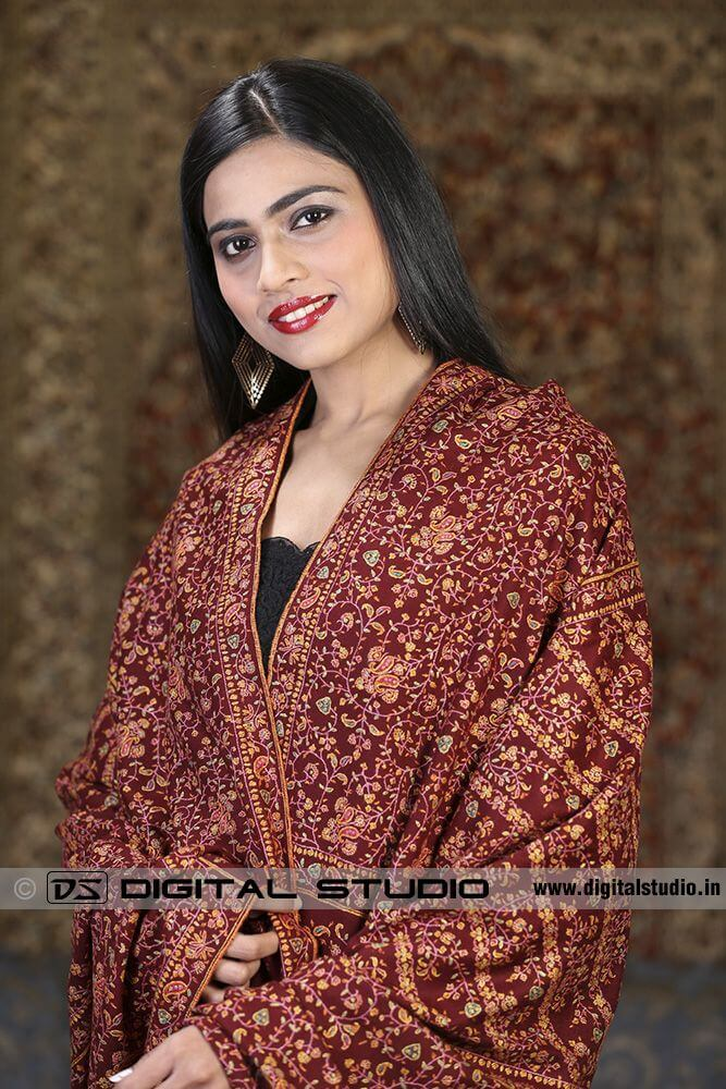 Model wearing embroidered pashmina shawl